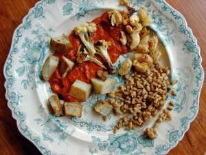Roasted potatoes, cauliflower and butterbeans with spicy red pepper sauce