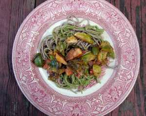 Soba noodles with arugula-pecan pesto and sauteed brussels sprouts