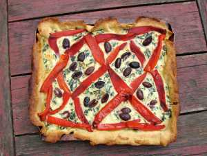 Ricotta tart with red peppers, chard and black olives
