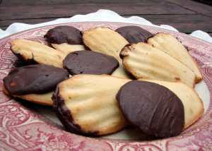 Chocolate-dipped framboise madeleines