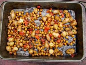 Roasted chickpeas, potatoes and tomatoes with sage and rosemary