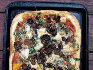 Roasted mushroom, spinach and brie pizza