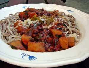 Soba noodles with roasted red pepper sauce, black beans, spinach and tomatoes.