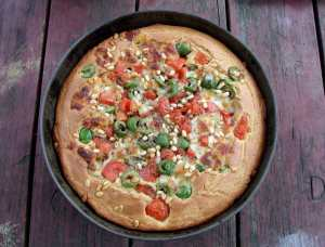 Savory cake with olives, tomatoes and mozzarella