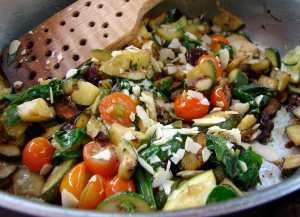 Zucchini and spinach with olives and almonds