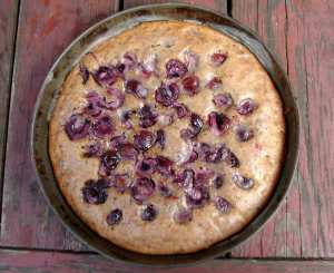 Almond cake with chocolate and cherries