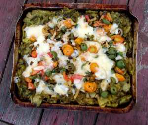 Pesto potato pie with fennel, tomatoes and olives