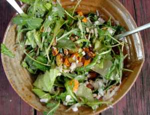 Arugula salad with roasted carrots, beets and pecans