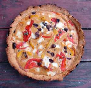 Roasted pepper tart with tomatoes, olives, and hazelnuts