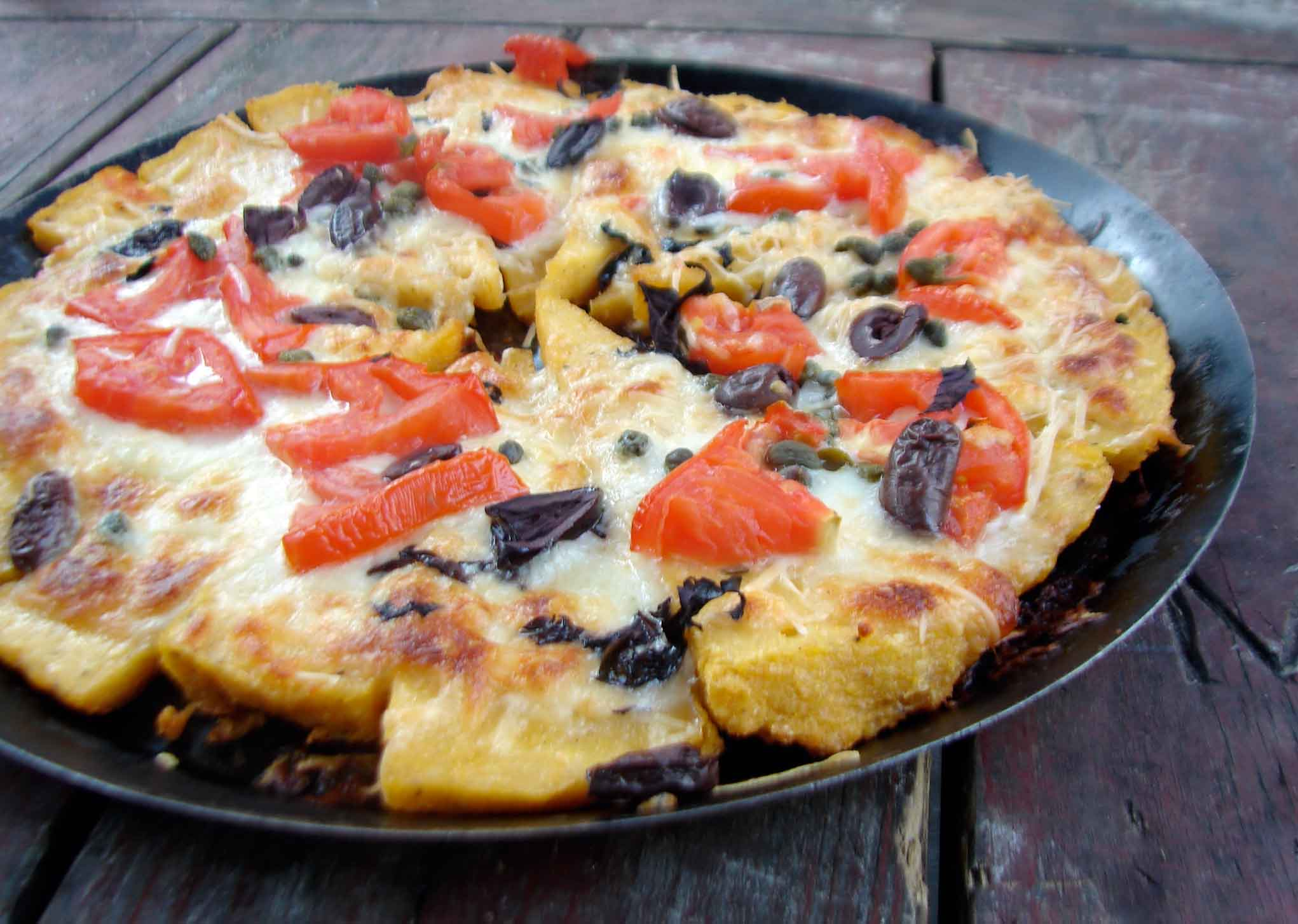 Polenta Pizza With Tomato And Pesto Recipe — Dishmaps