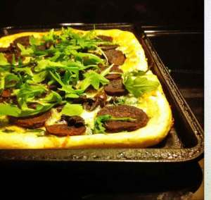 Purple sweet potato pizza with arugula
