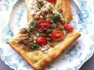 White bean, olive and pistachio pizza