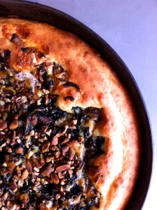 Savory cake with chard, mushrooms, pecans and pistachios