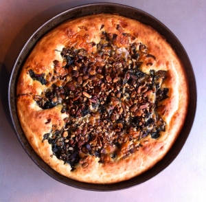 Savory cake with chard, roasted mushrooms, pecans and pistachios