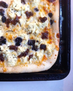Pizza with sweet potatoes, olives, capers, and caramelized onions