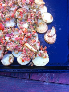 Potatoes with goat cheese, olives and capers