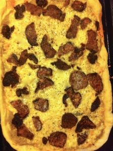 Pizza with olive-pistachio tapenade and breaded eggplant and mushrooms