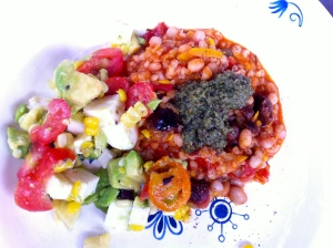 White bean chili with pesto and avocado corn salsa
