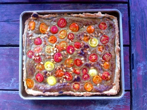 Beet and squash tart with cherry tomatoes and pine nuts