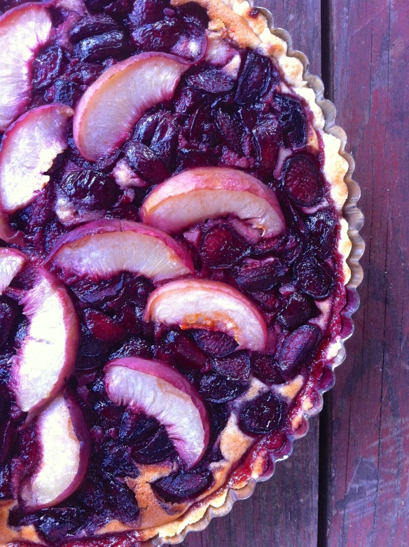 Cherry, white peach, chocolate, and almond tart